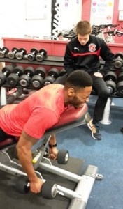 Jamille Matt training in the weights area at YMCA Fleetwood with Andy Monks